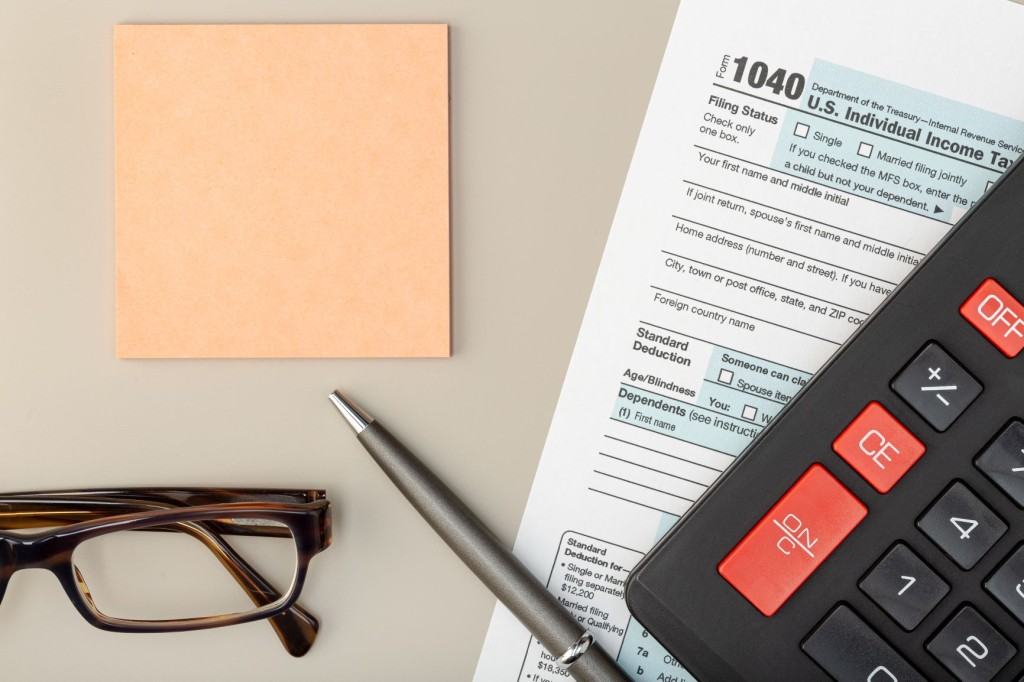 individual-tax-return-form-on-table-FX92BD5 red
